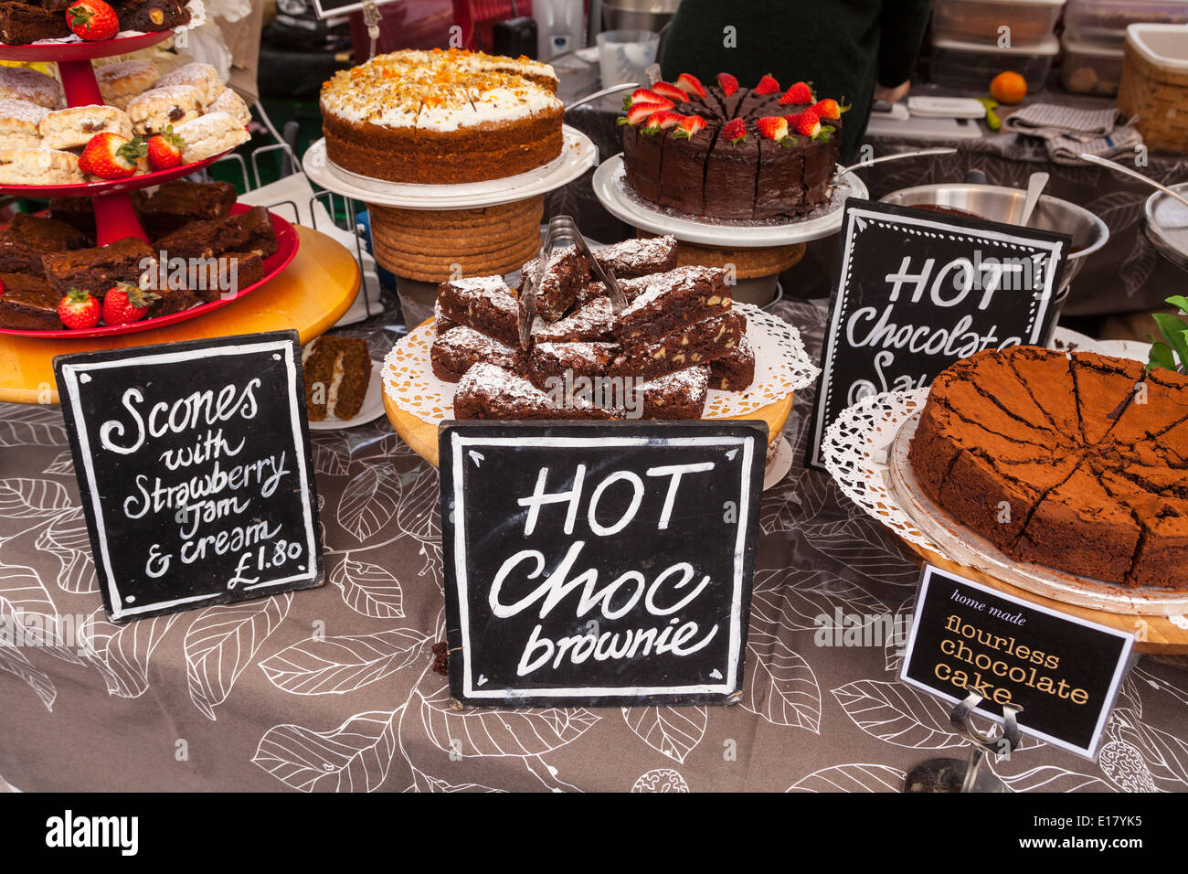 Handmade cakes for sale on a stall in Camden Market, London. Stock Photo