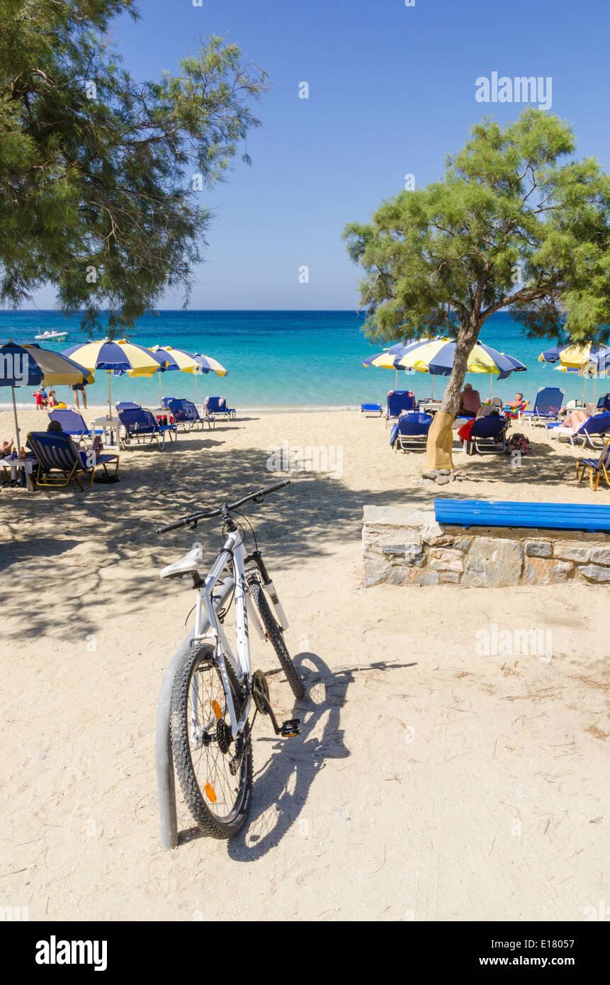 A bike next to Agios Prokopios Beach on Naxos Island, Cyclades, Greece Stock Photo