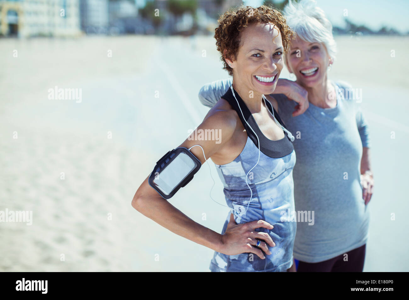 Portrait of smiling women in sportswear outdoors - Stock Image