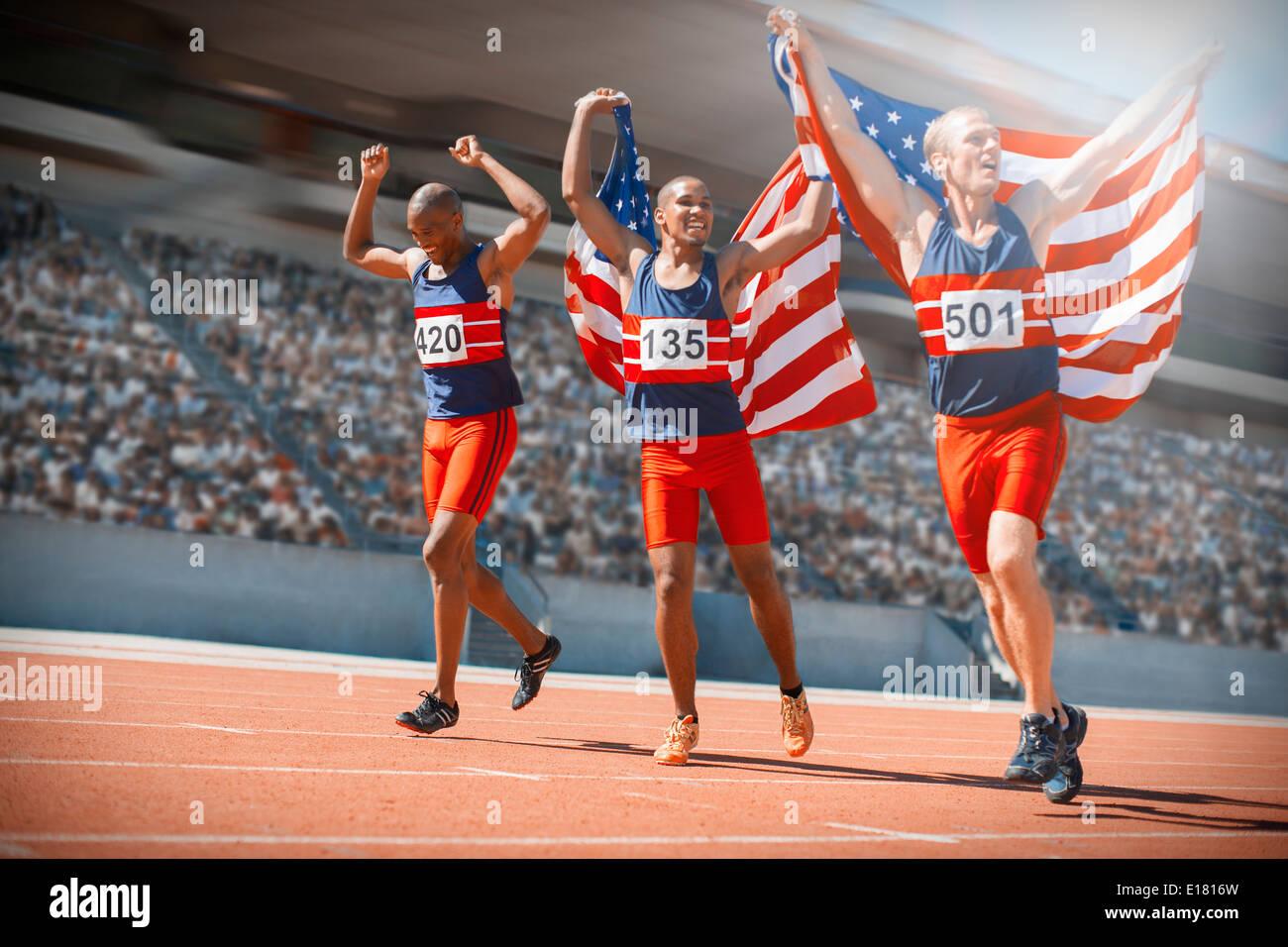 American athletes celebrating on track Stock Photo