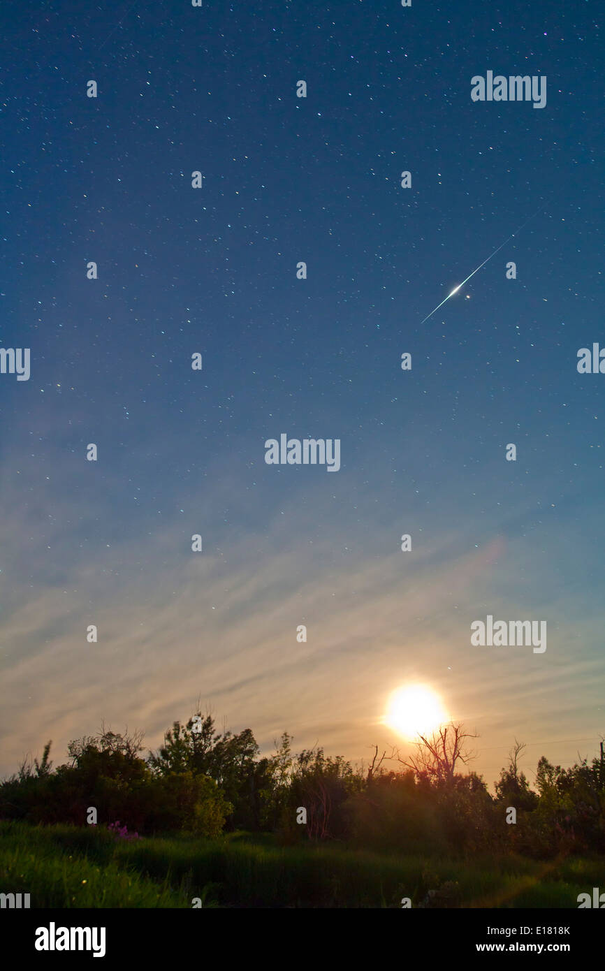Bright -6 magnitude Iridium flare, June 21, 2010, at 12:28 am MDT, moving from south to north. Stock Photo