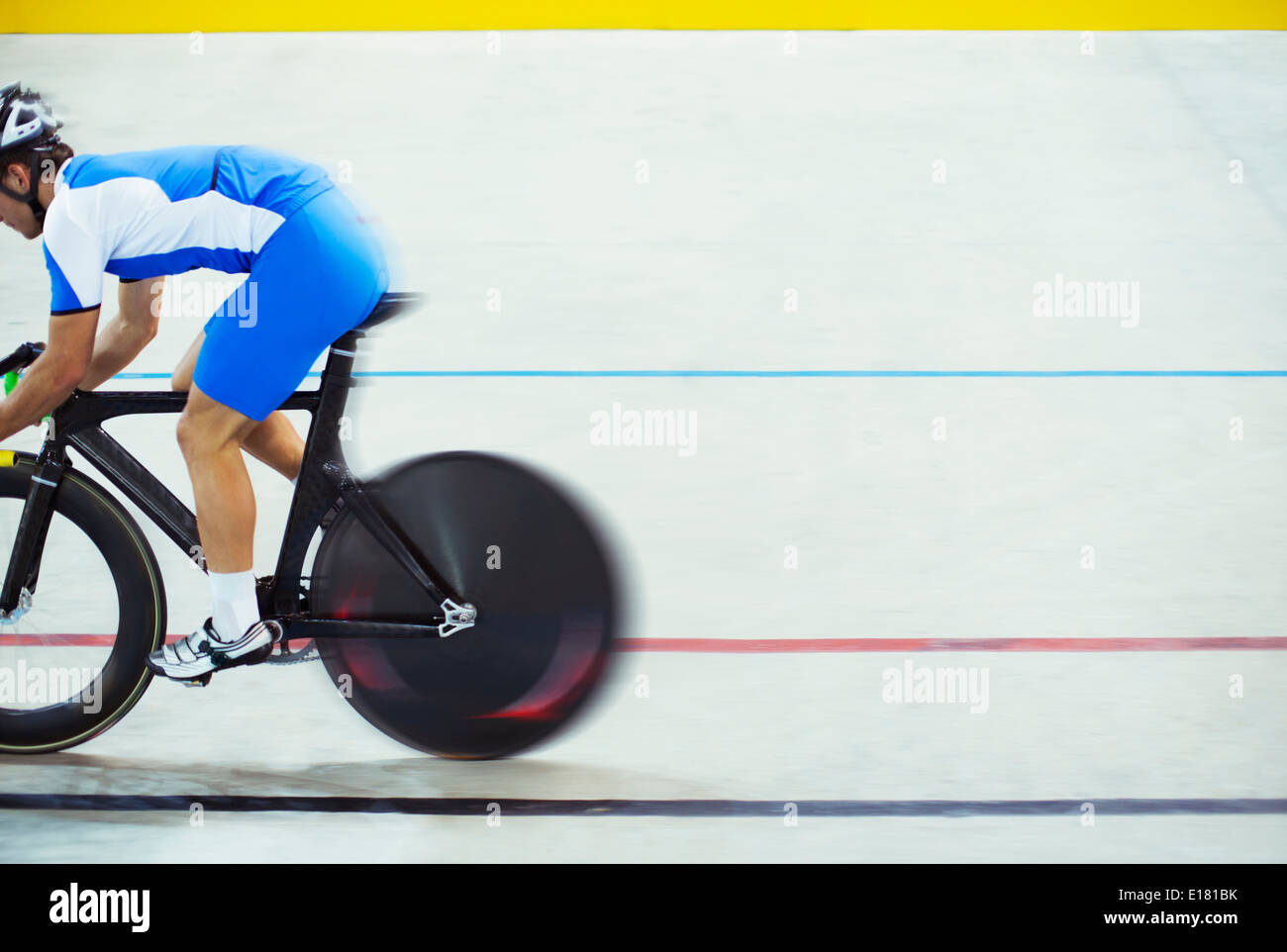 Track cyclist riding in velodrome - Stock Image