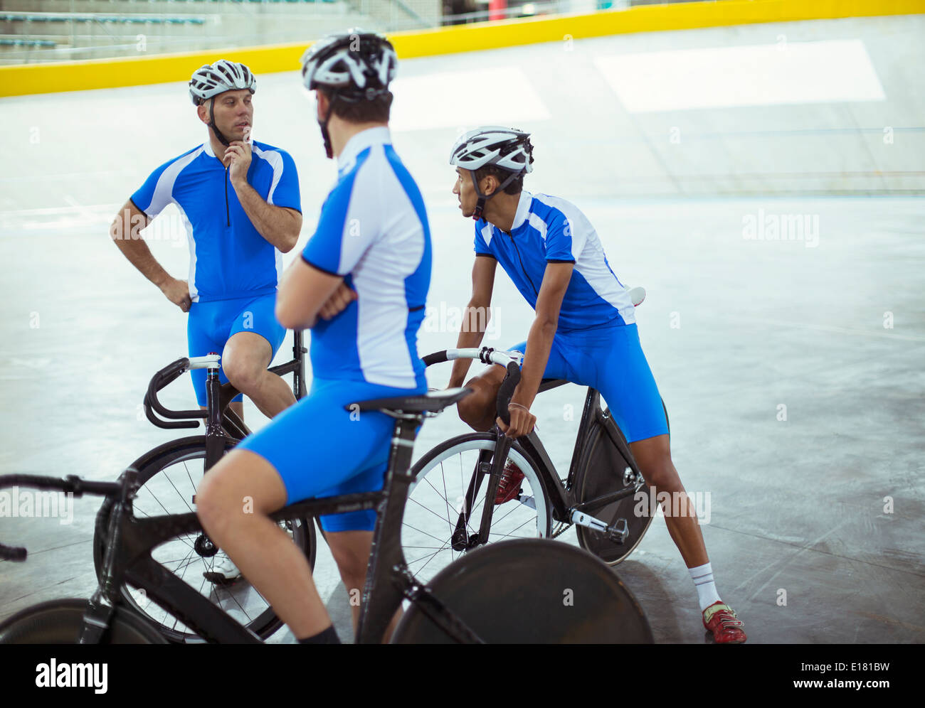Track cycling team talking in velodrome - Stock Image