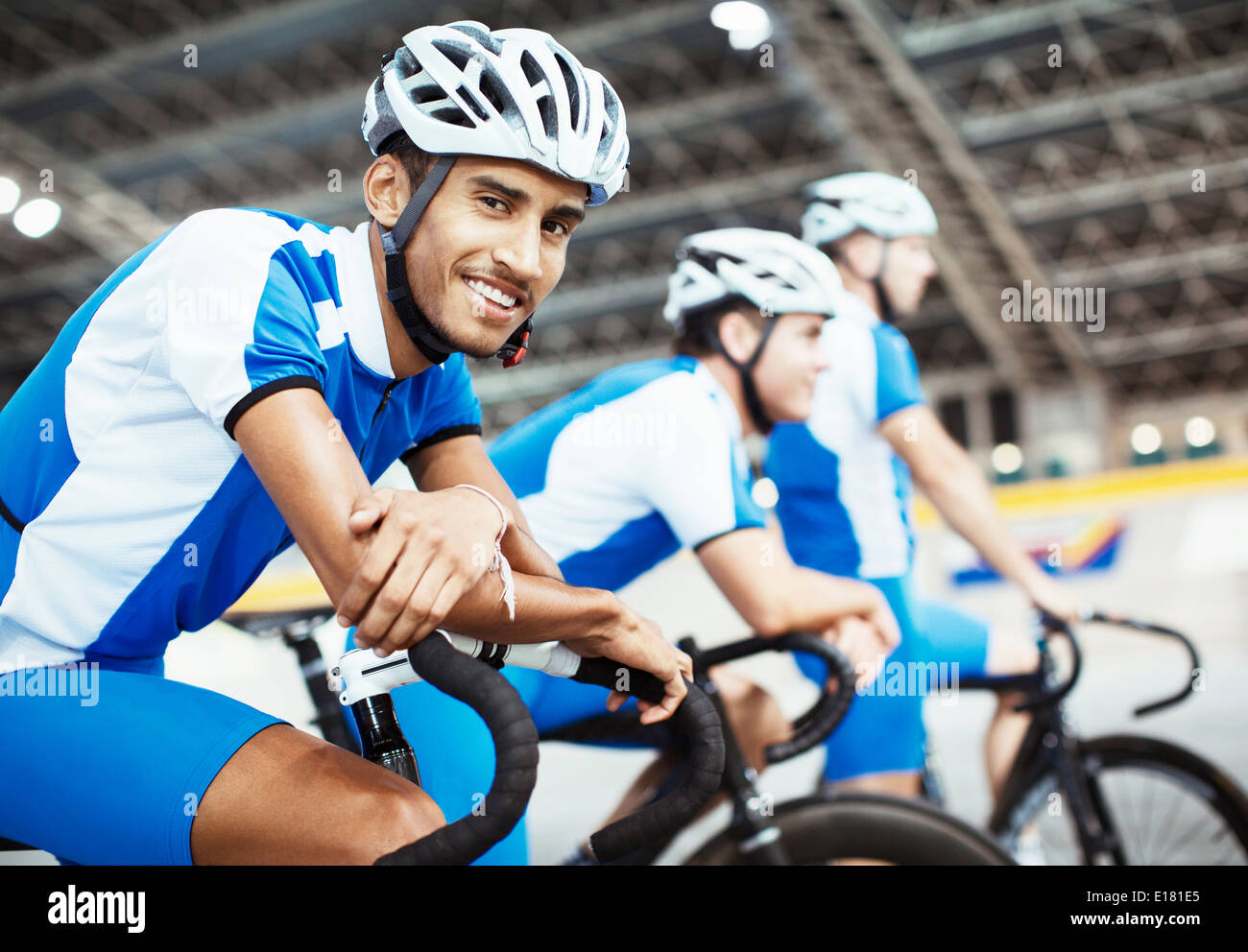Track cycling team waiting in velodrome - Stock Image