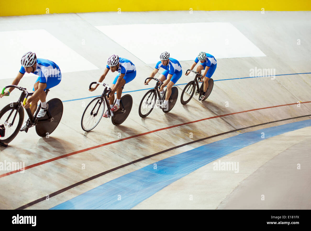 Track cycling team riding in velodrome - Stock Image