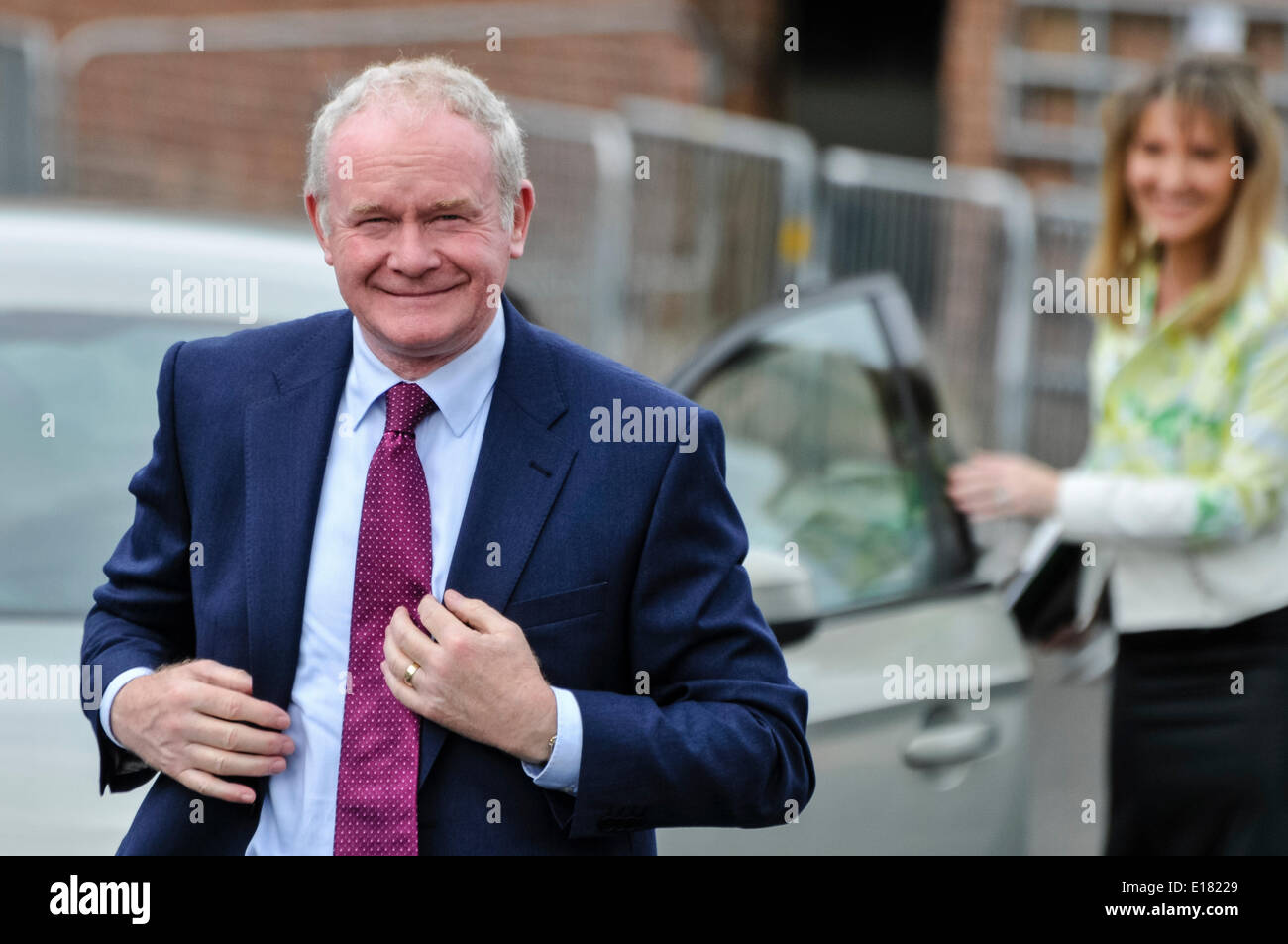 Belfast, Northern Ireland. 26 May 2014 - Sinn Fein Deputy First Minister Martin McGuinness gets out of a car with Martina Anderson MEP, Belfast Credit:  Stephen Barnes/Alamy Live News - Stock Image