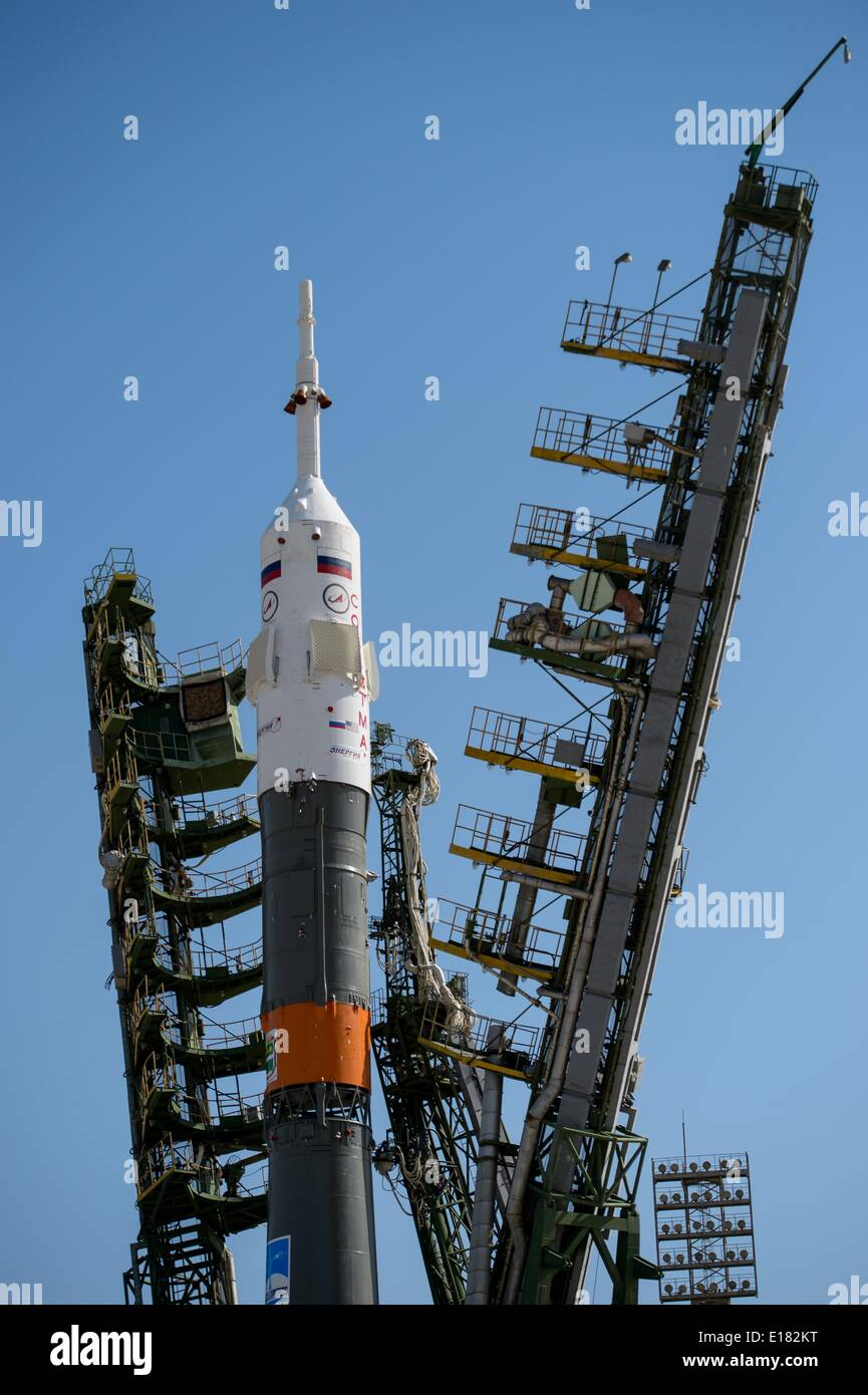 The Roscosmos Soyuz TMA-13M spacecraft is moved into vertical position as the gantry is closed on the launch pad in preparation for launch to the International Space Station May 26, 2014 at the Baikonur Cosmodrome in Kazakhstan. - Stock Image