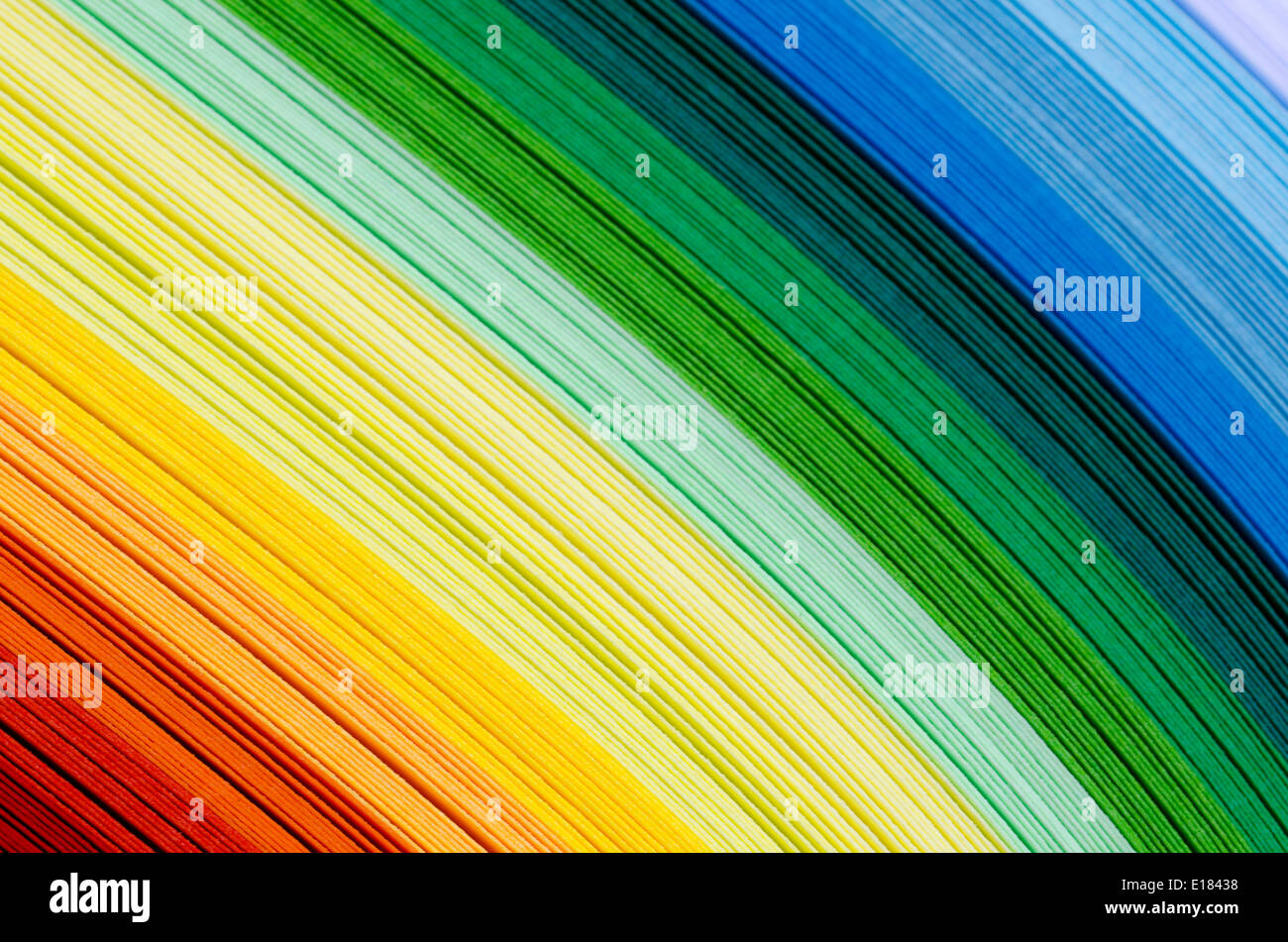 paper sheets in rainbow color spectrum - Stock Image