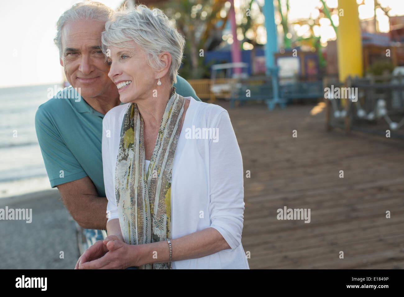 Senior couple at amusement park Stock Photo