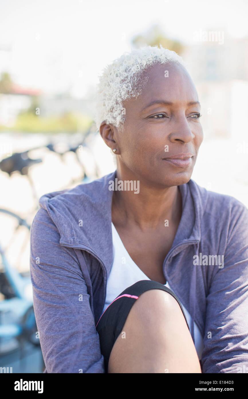 Pensive woman looking away - Stock Image