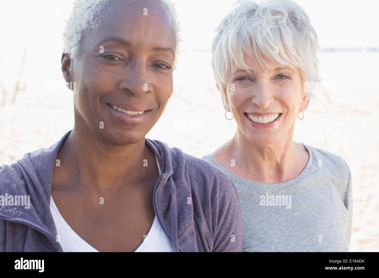 Portrait of smiling senior women - Stock Image