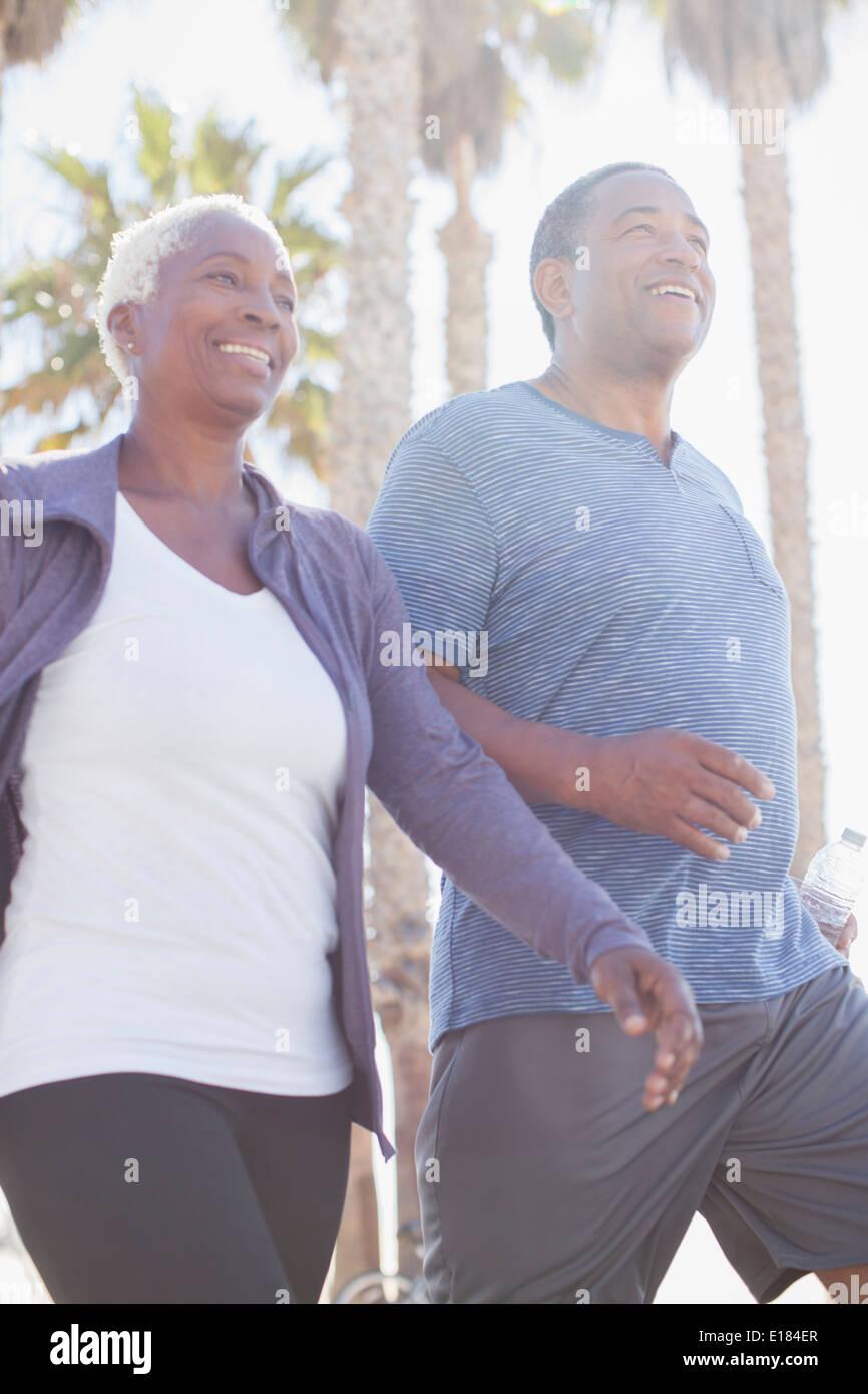 Senior couple power walking outdoors - Stock Image