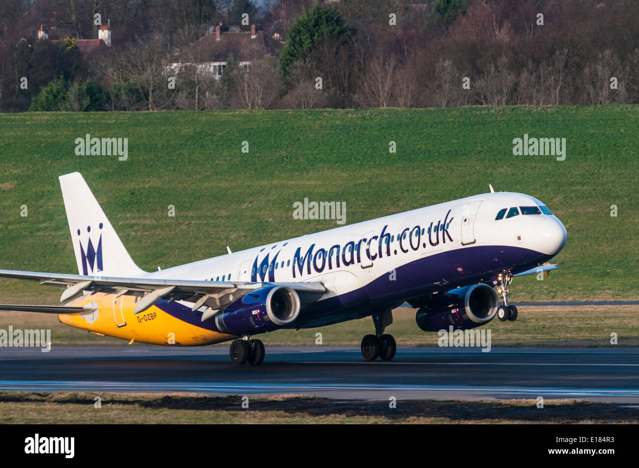 Airbus A321 of Monarch Airlines taking off from Birmingham International Airport Stock Photo