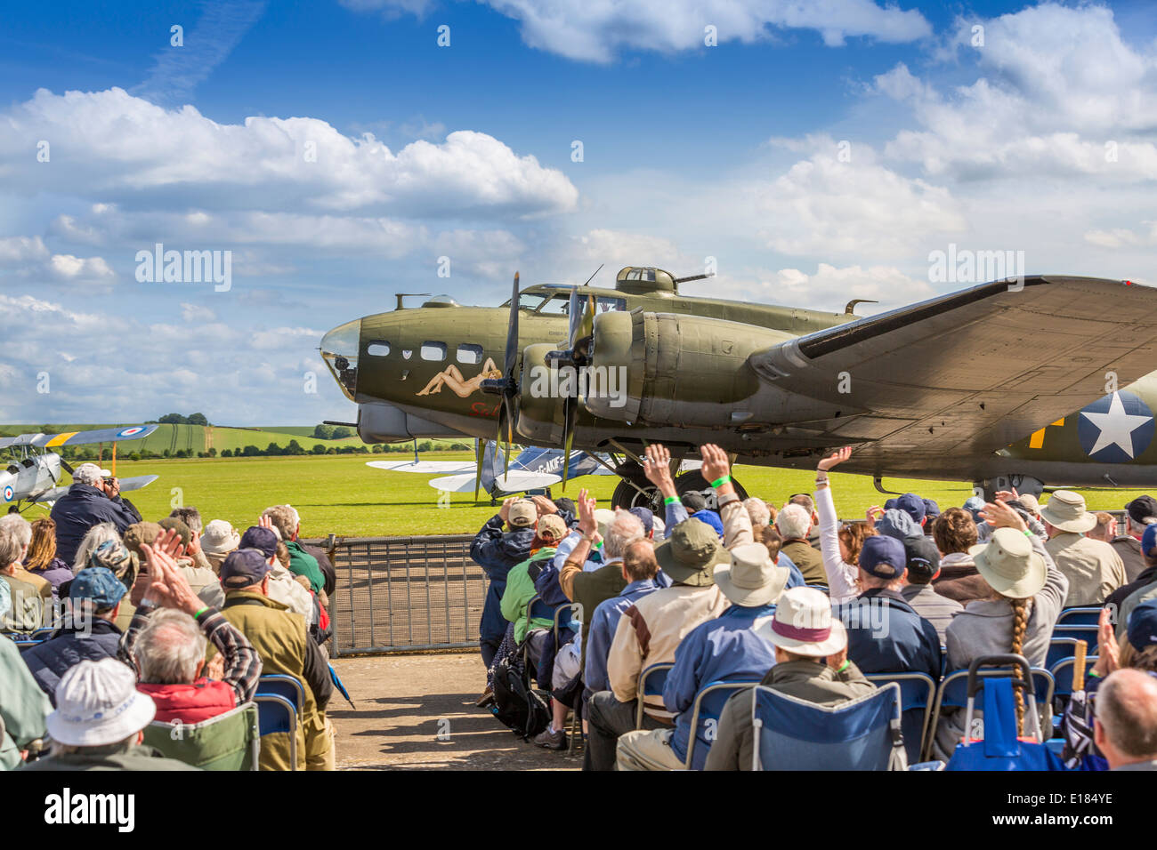 Sally B, a Boeing B17 Flying Fortress, taxi past fans and spectators at a Duxford airshow, Duxford ,Cambridge, England UK - Stock Image