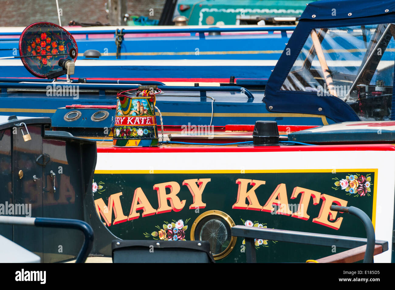 Colourful painted decorations on canal boats moored side by side in Brayford Pool in Lincoln - Stock Image