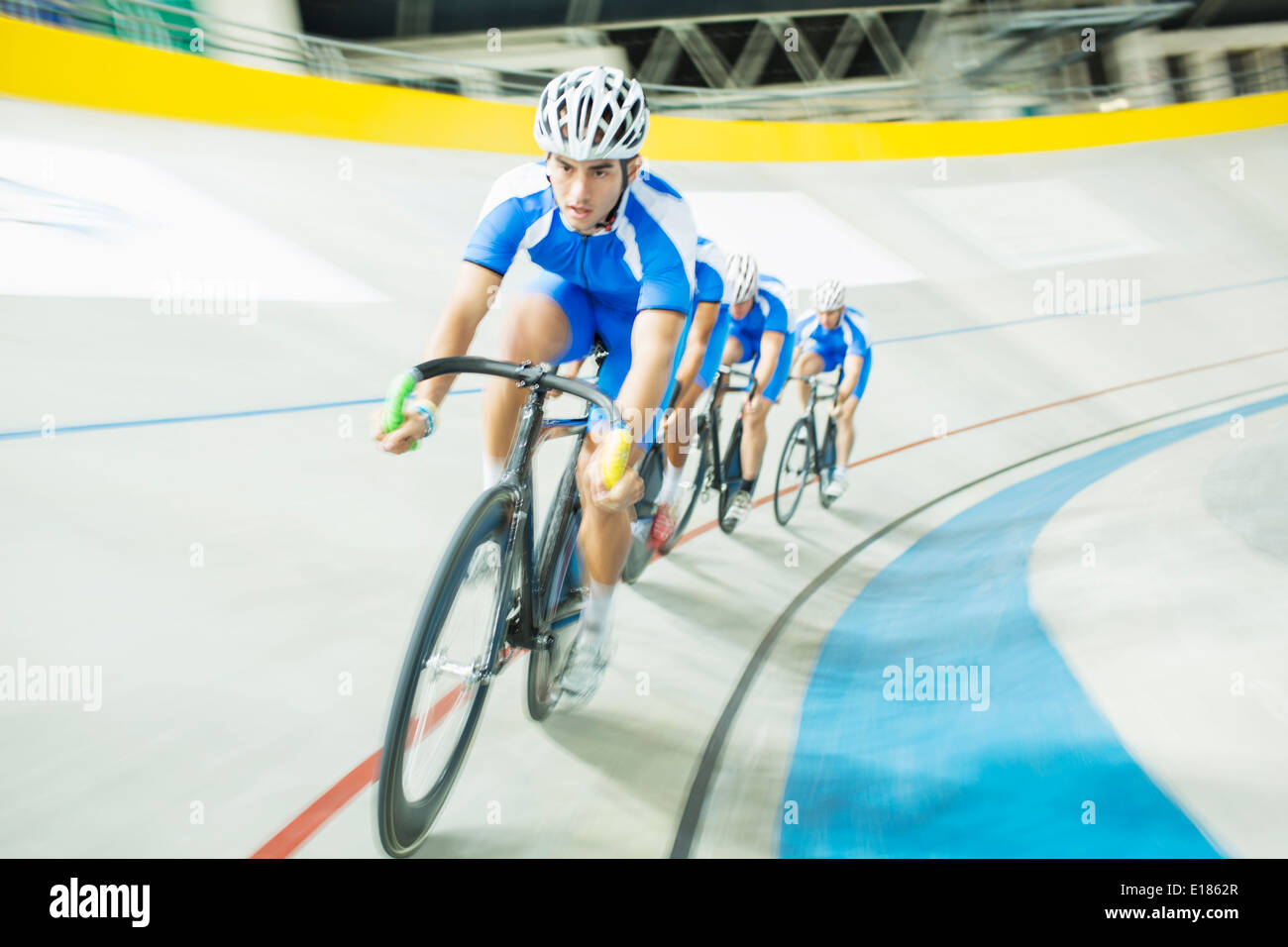 Track cyclist racing in velodrome - Stock Image