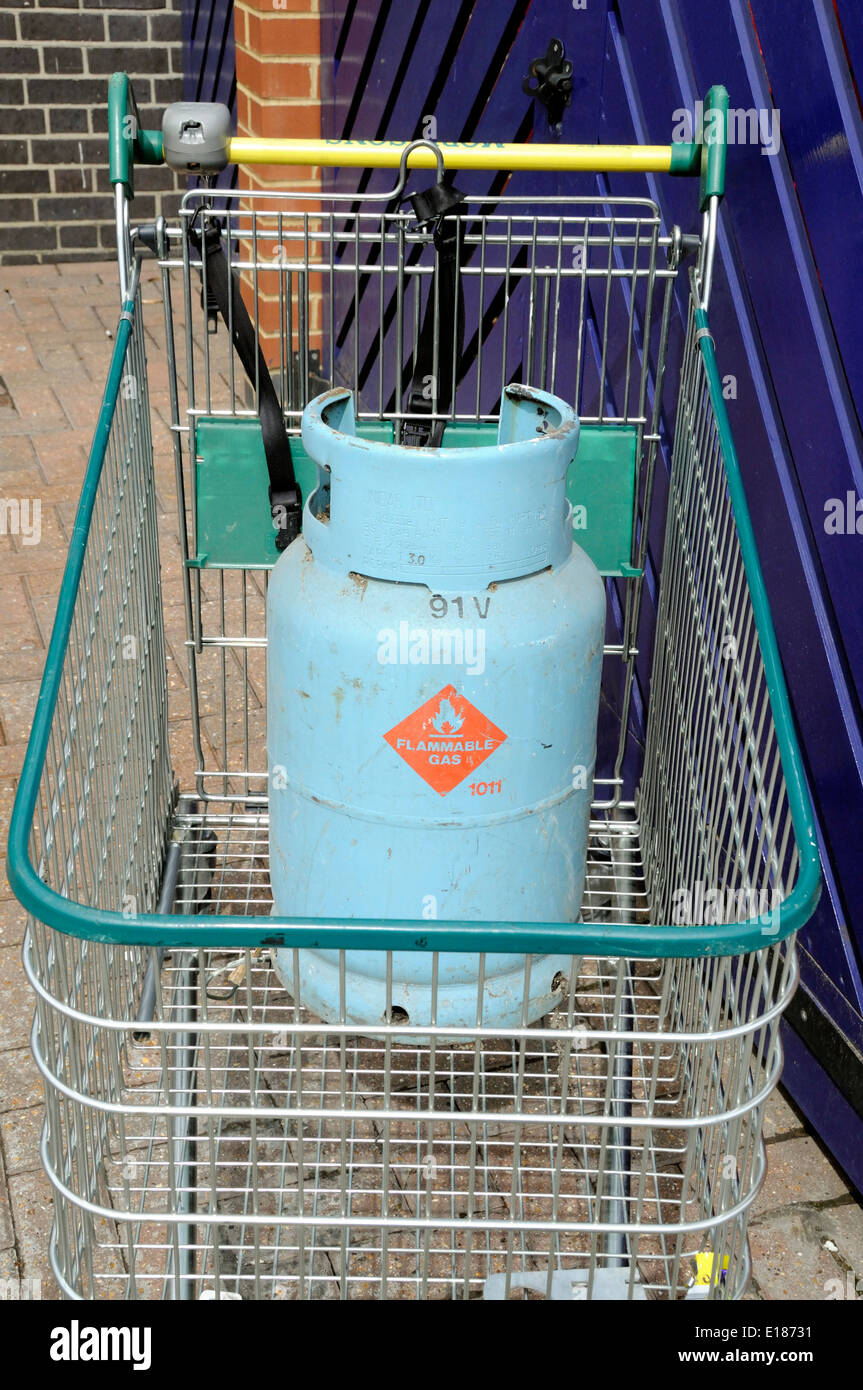 Flammable gas canister left in Morrison shopping trolley, Highbury, London Borough of Islington England UK - Stock Image