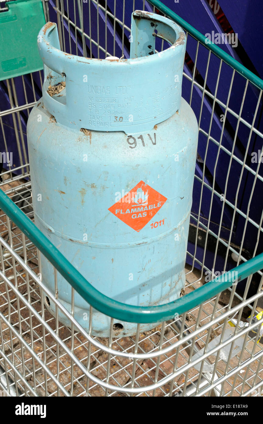 Flammable gas canister left in shopping trolley, Highbury, London Borough of Islington England UK - Stock Image