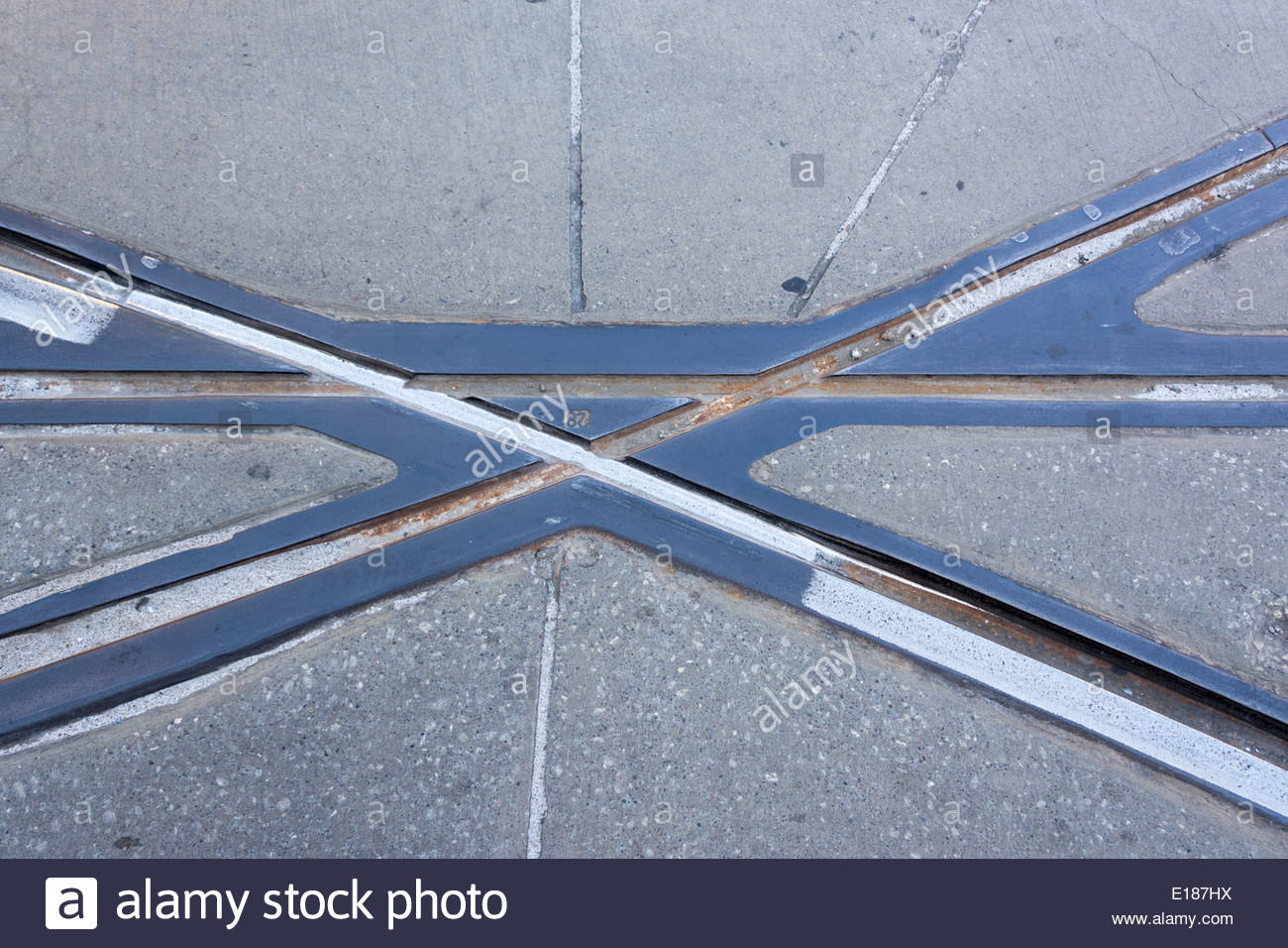 Abstract of the streetcars rails in Toronto. Detail of railroad in the street concrete. - Stock Image