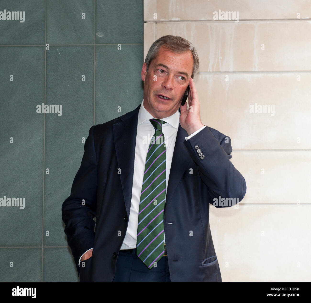 Nigel Farage Victory on phone outside Intercontinental Hotel Broadway Street London Uk with UKIP Team to celebrate MEP election 2014 Credit:  Prixnews/Alamy Live News - Stock Image