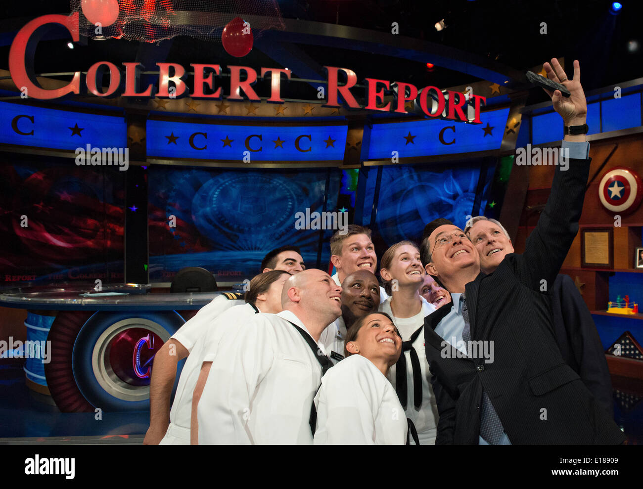 Comedian Stephen Colbert takes a selfie with Secretary of the Navy Ray Mabus and Sailors during Fleet Week 2014 May 22, 2014 in New York City. - Stock Image