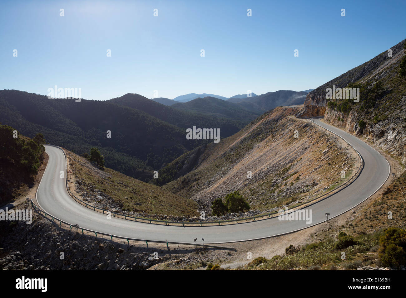 View of mountains and winding road - Stock Image
