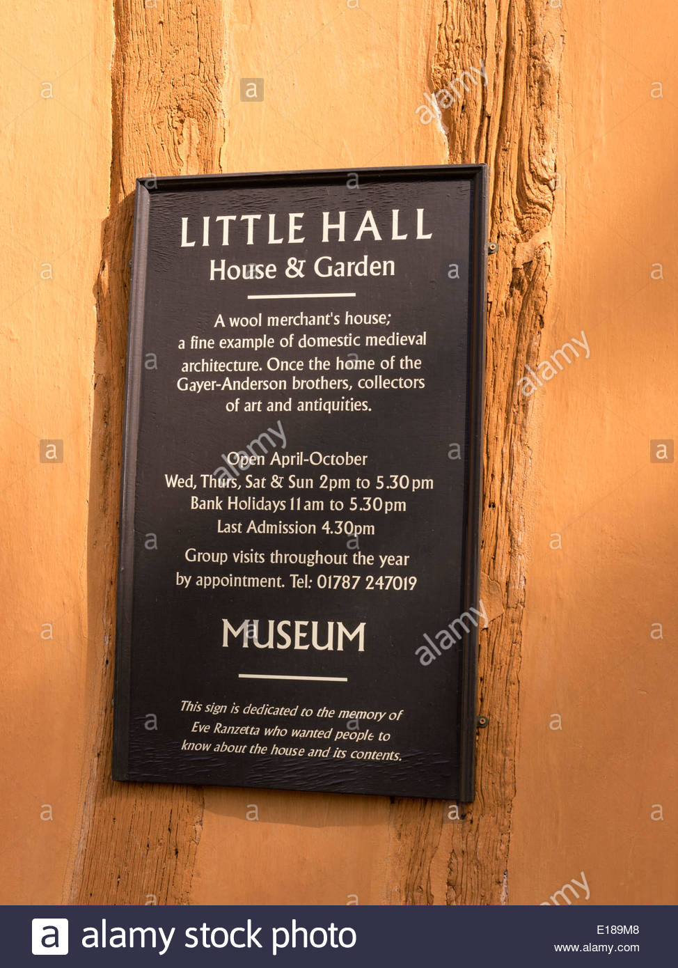 Sign outside the old Medieval half timbered oak post and beam house of Little Hall, Lavenham, Suffolk, England, UK - Stock Image