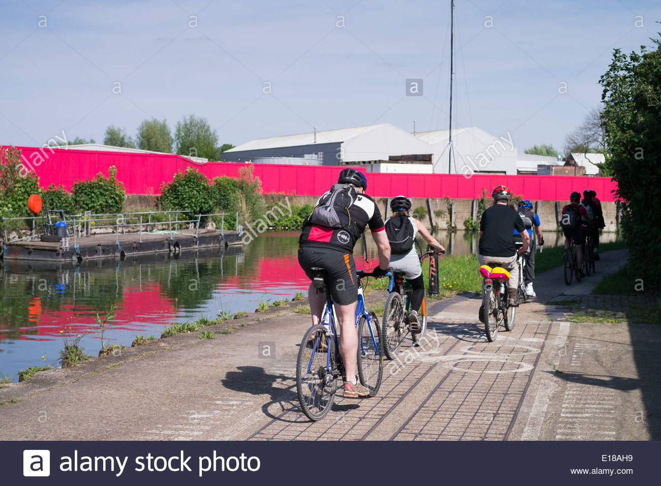 Cyclists on the Bow Back Rivers towpath: East London. - Stock Image