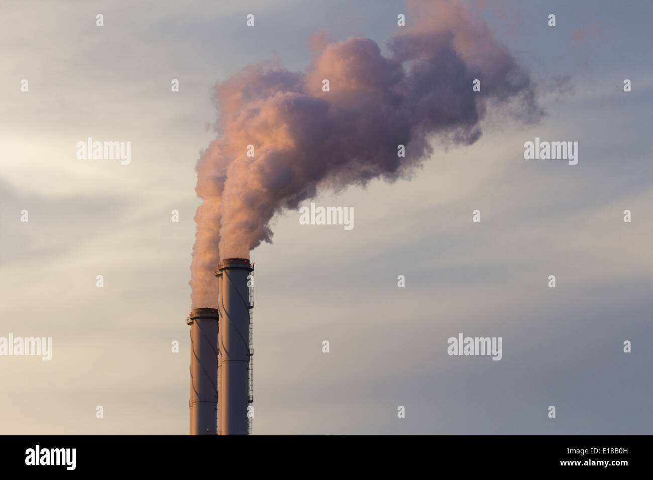 Smoke emission from factory pipes - Stock Image