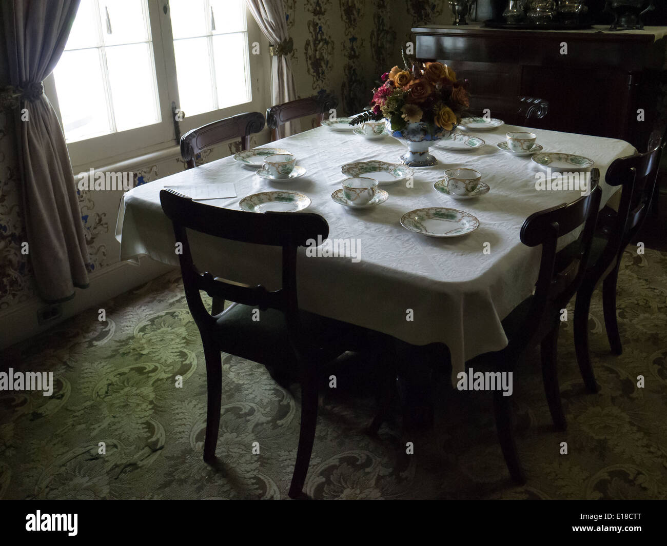vintage dining table at colborne lodge - Stock Image