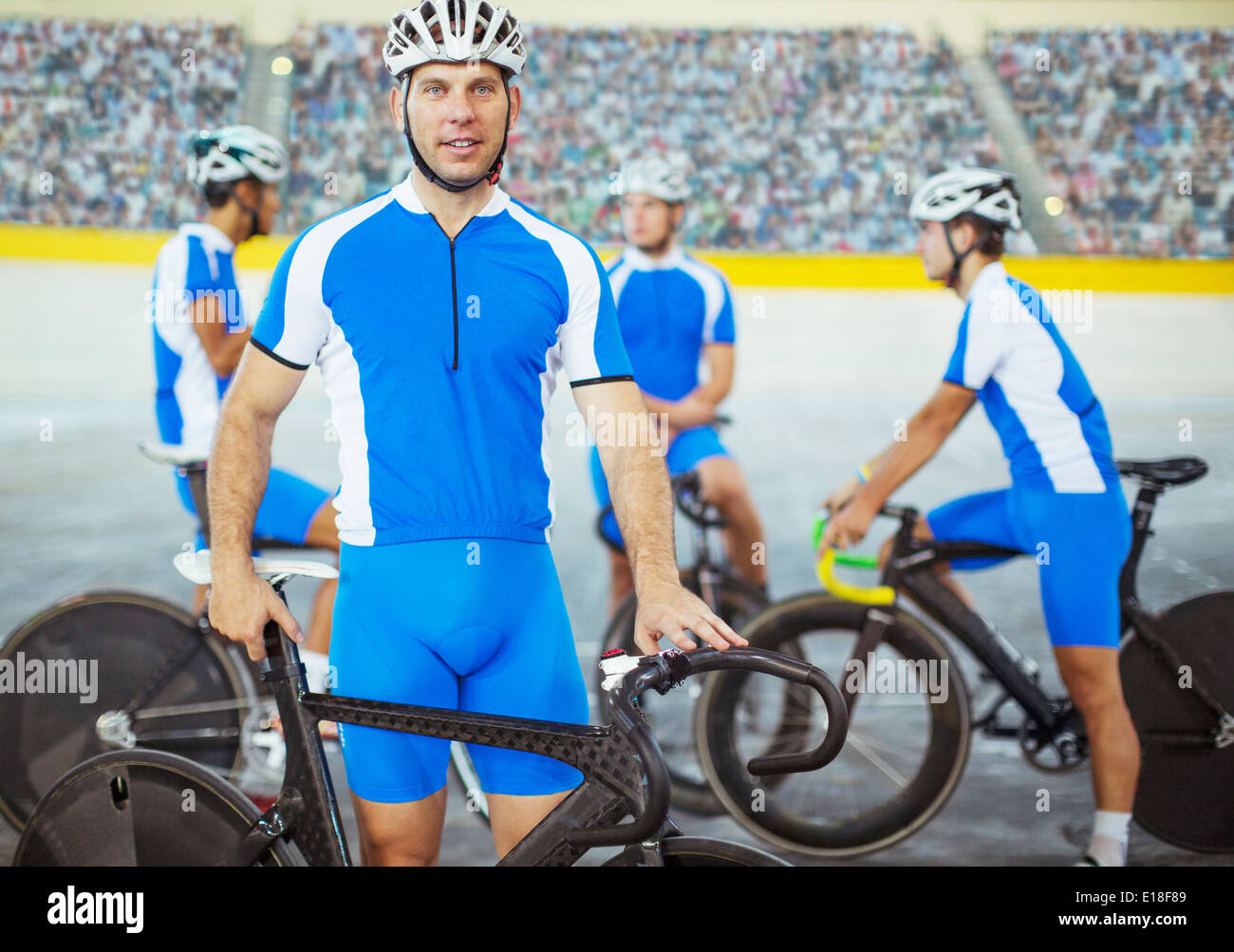 Track cyclists standing in velodrome - Stock Image