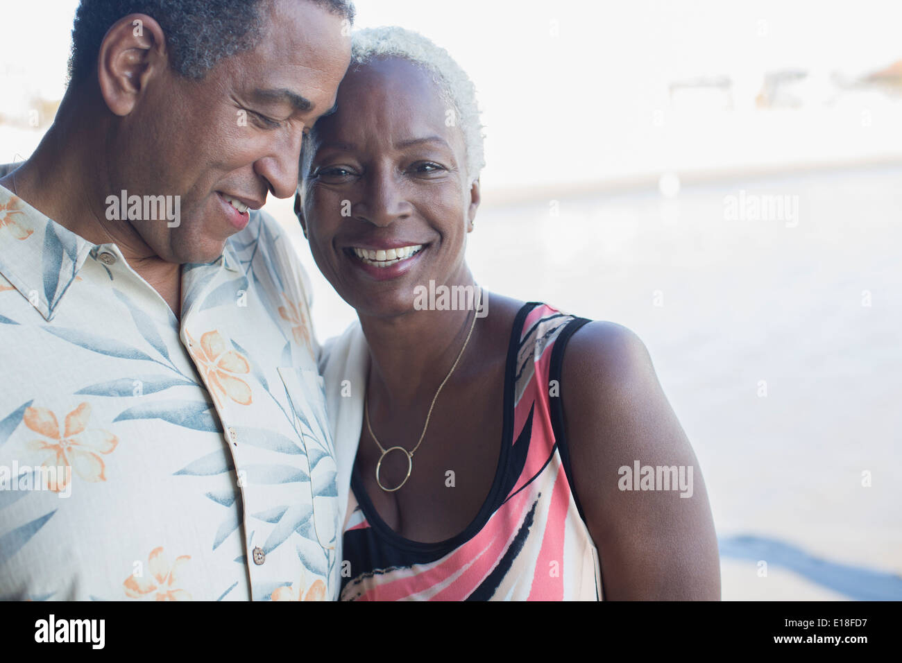 Portrait of senior couple hugging - Stock Image