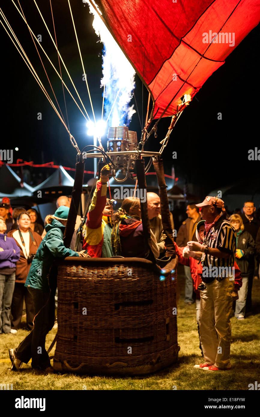Hot air balloon crew in basket and gas flame, Albuquerque International Balloon Fiesta, Albuquerque, New Mexico USA Stock Photo