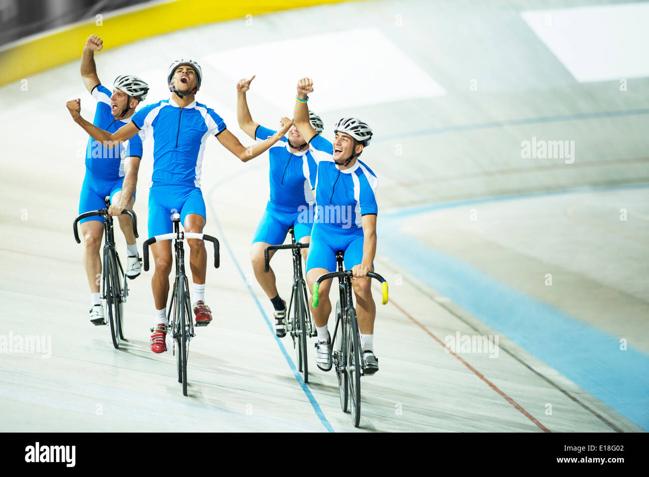 Track cycling team celebrating on track - Stock Image