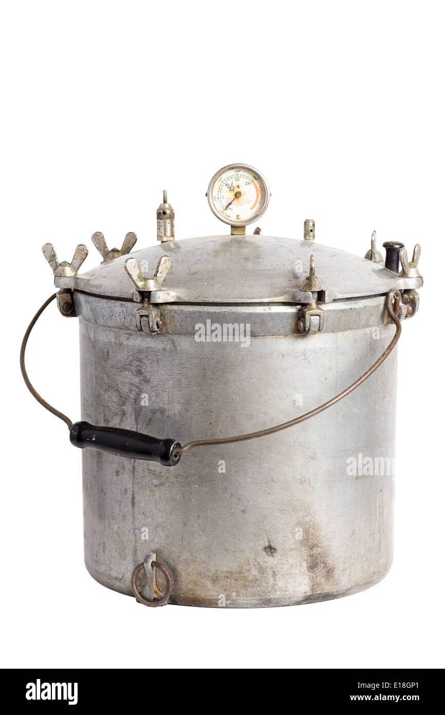 Antique aluminum pressure cooker-canner on a solid white background - Stock Image