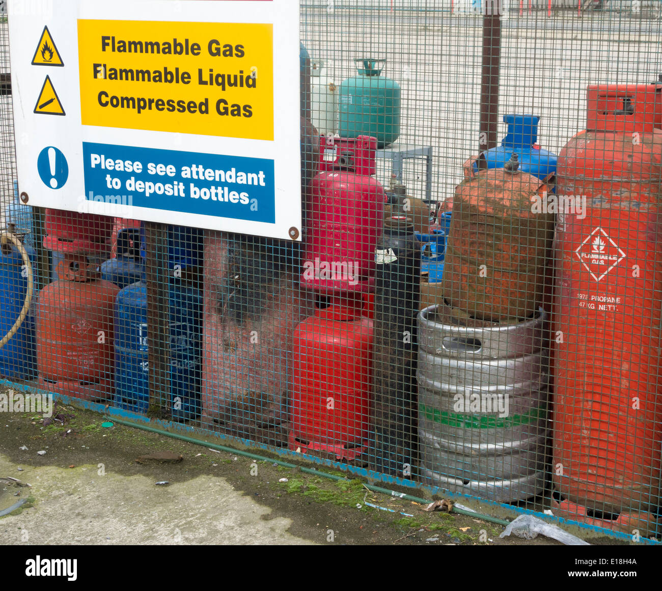 Old gas bottles at Council recycling site for household waste. England. UK - Stock Image