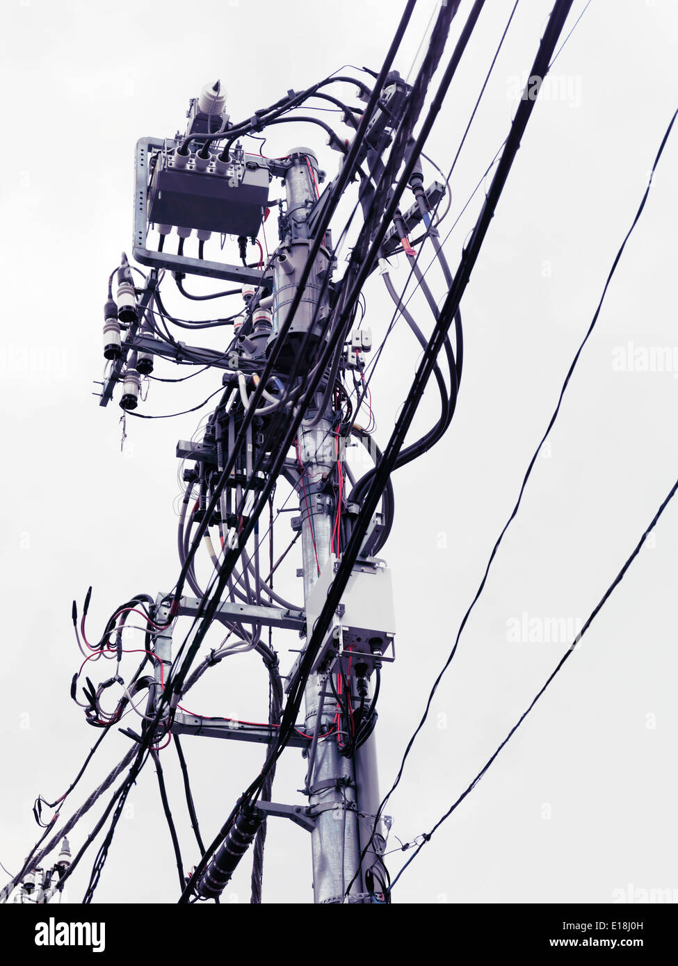 Complex busy electric overhead wiring in Tokyo Japan - Stock Image