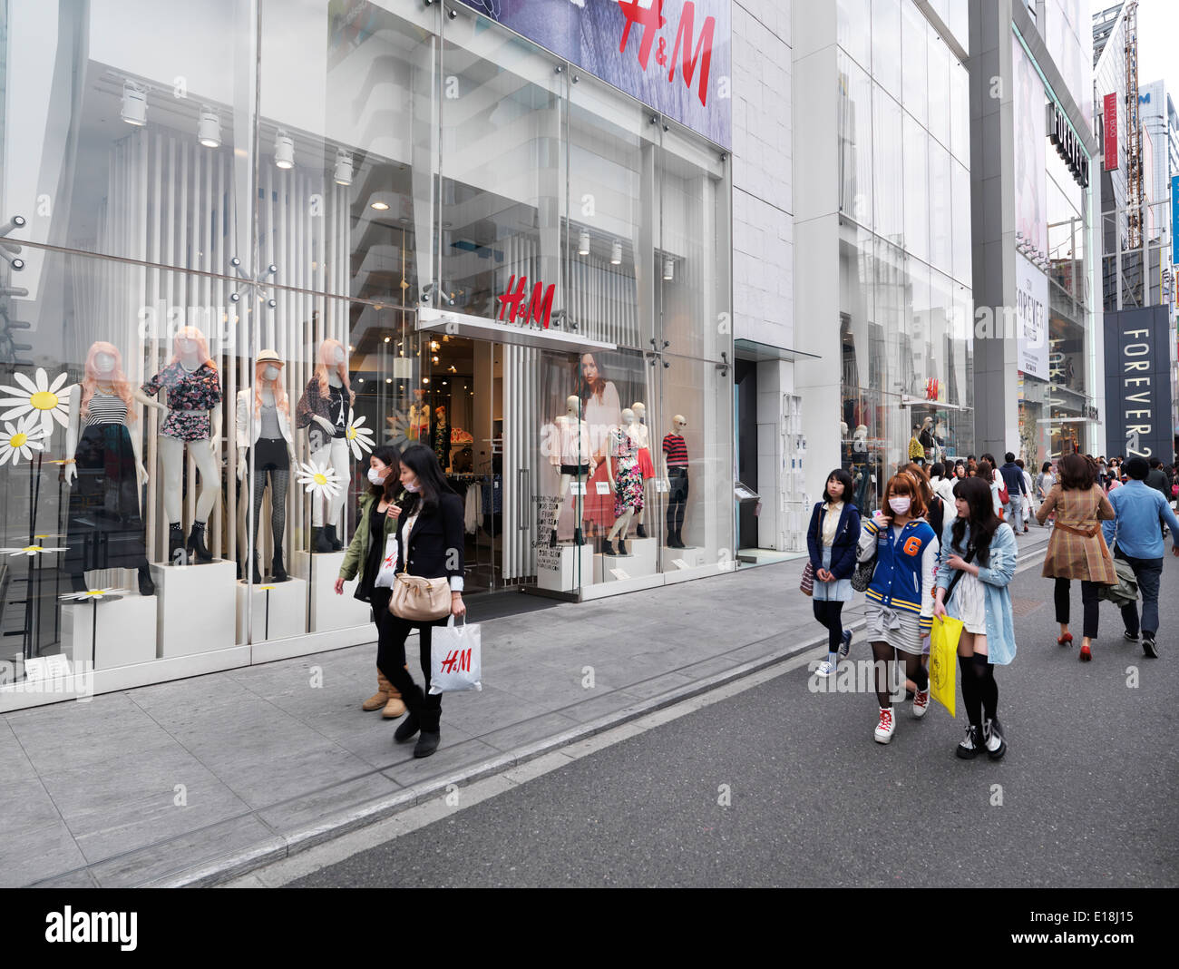 cb79f5e5d6e Young people walking on streets in one of Tokyo's fashion districts. HM and  Forever 21