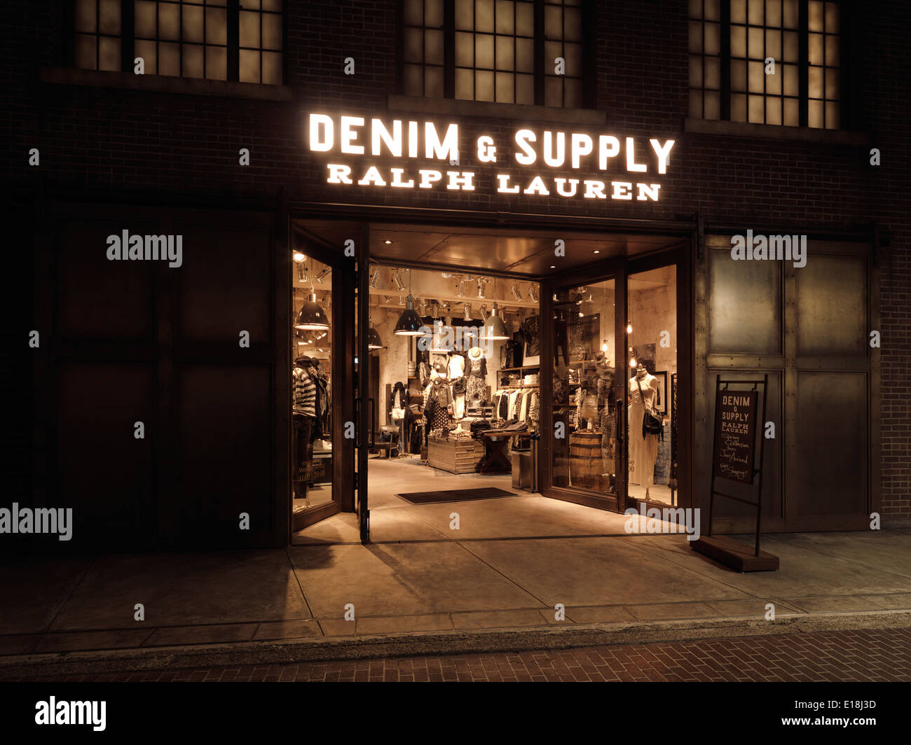 Ralph Lauren Denim and Supply, vintage styled fashion clothing store at night. Harajuku, Tokyo, Japan. - Stock Image