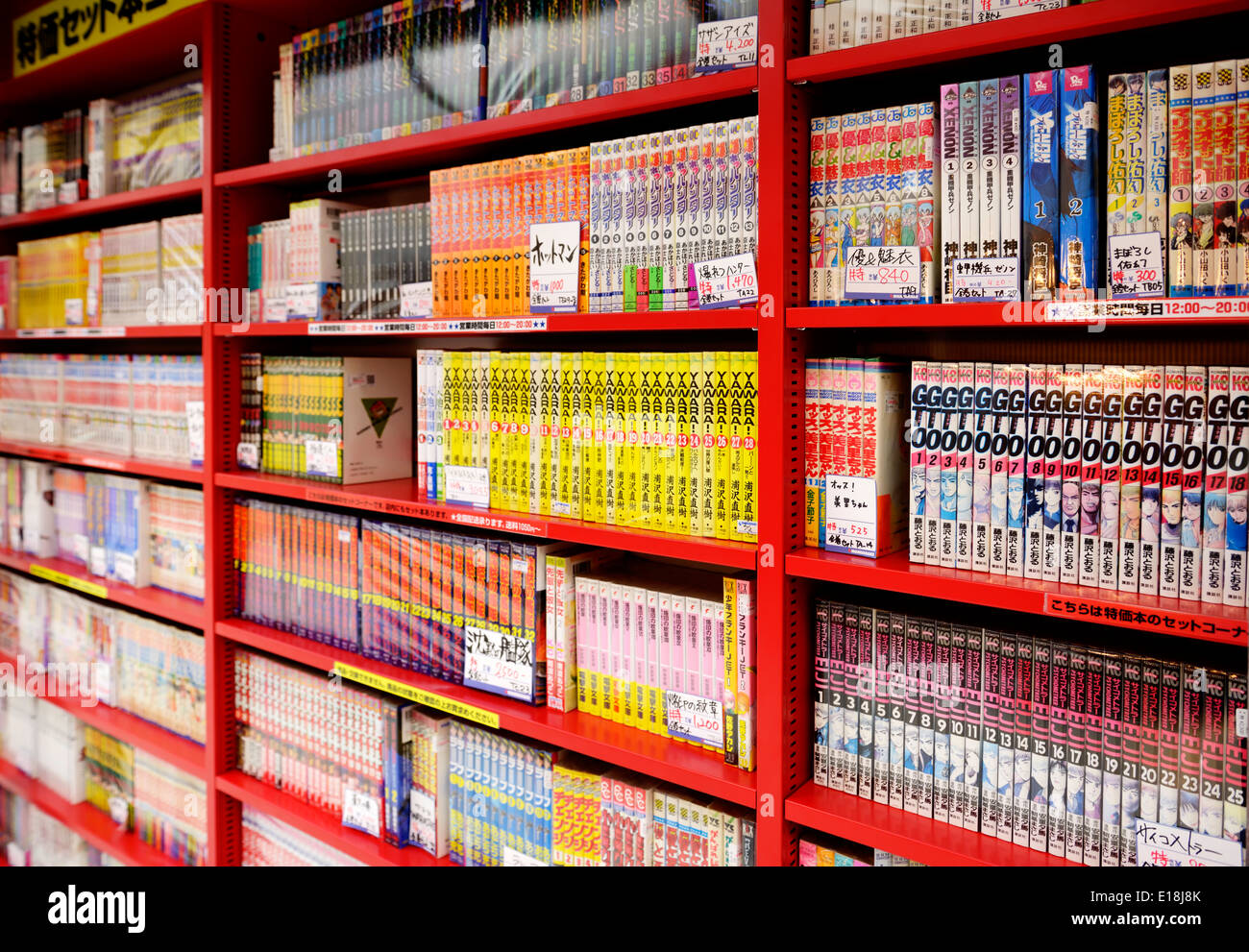 Manga comics books on book shelves at a Japanese store. Tokyo, Japan. - Stock Image