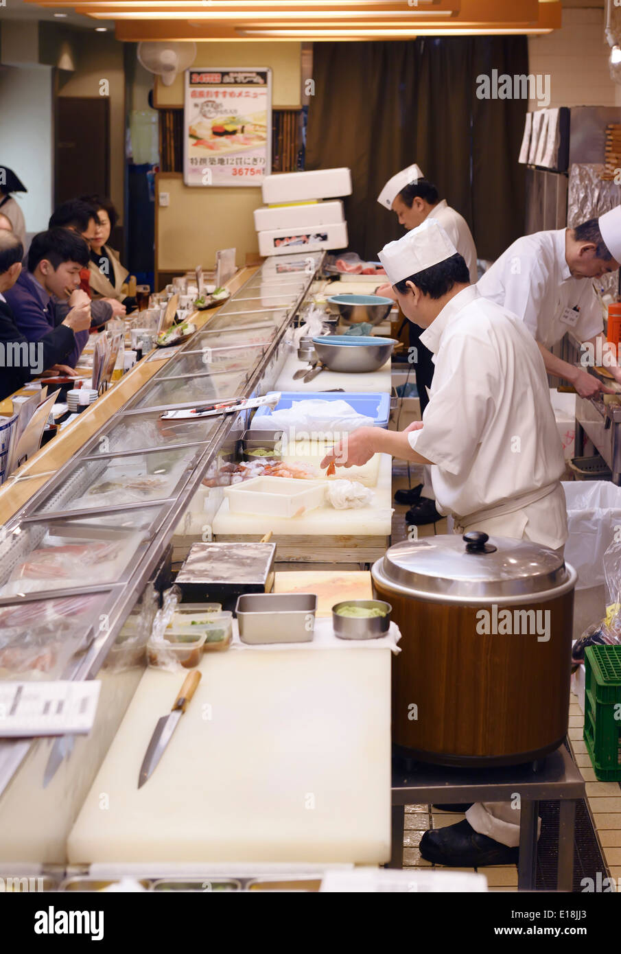 Japanese sushi restaurant cooks in the kitchen. Itamae. Tokyo, Japan. - Stock Image