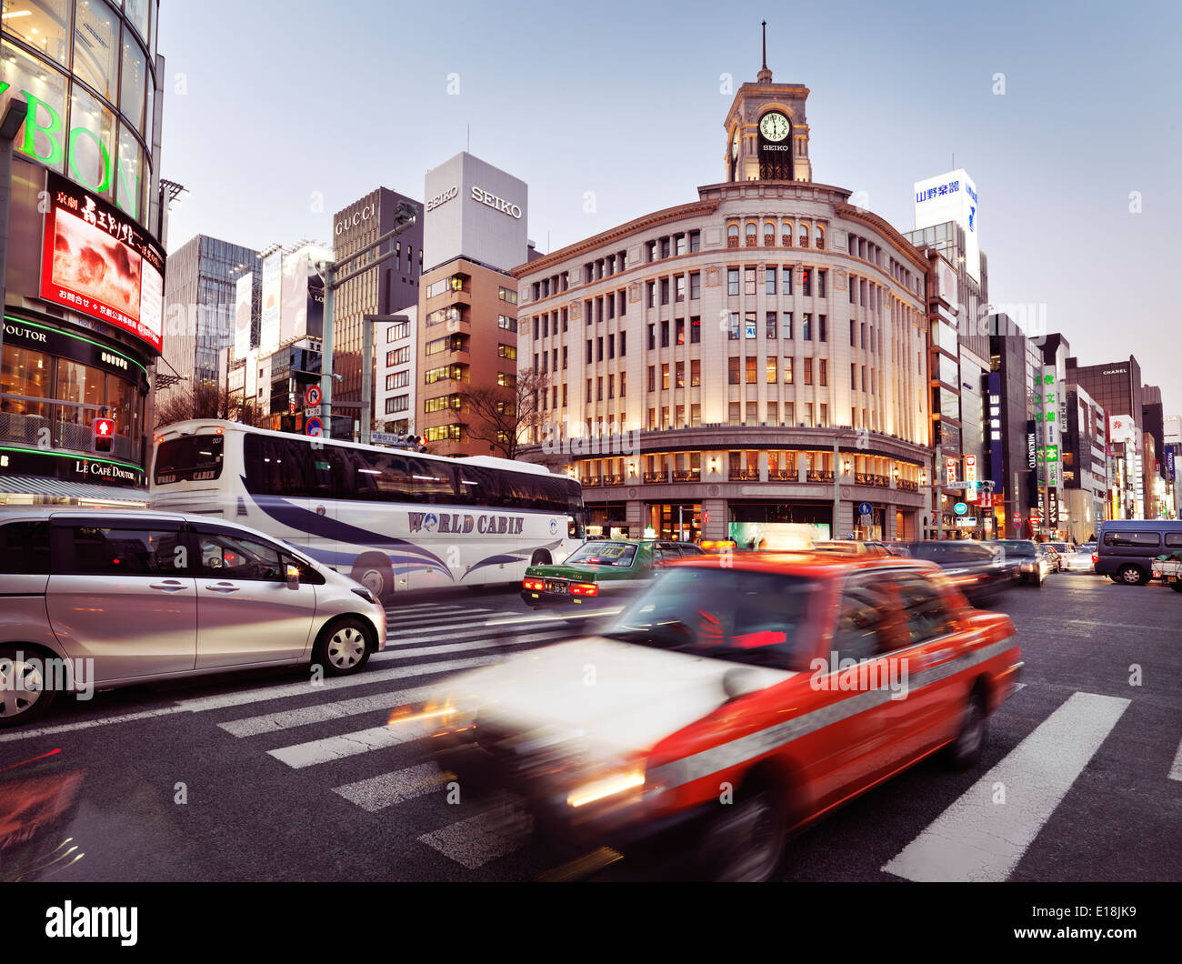 Rush hour city traffic on Chuo Dori street in front of Wako Department Store building in Ginza, Tokyo, Japan 2014. Stock Photo
