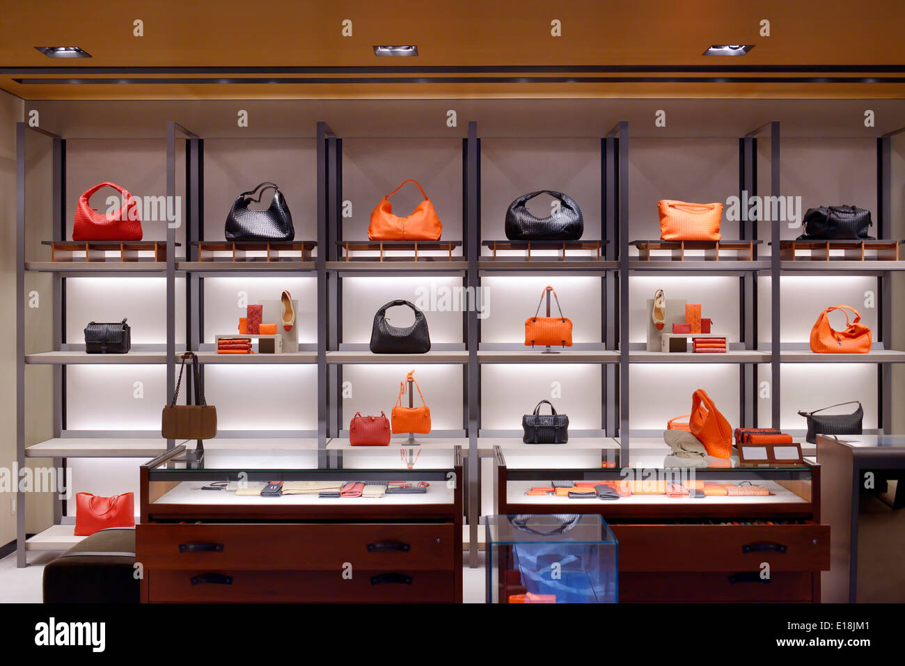 Womens purses on display in a store - Stock Image