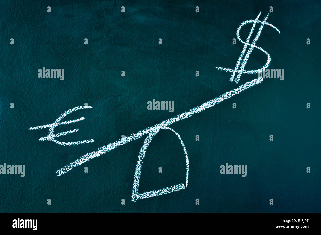 euro and dollar signs in a balance scale, depicting the idea of heavier weight of the euro against the dollar - Stock Image