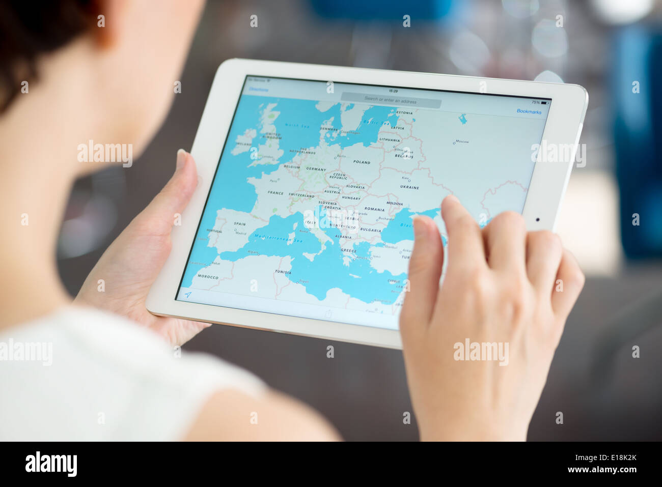 Woman looking on Google Maps application on a brand new white Apple iPad Air Stock Photo
