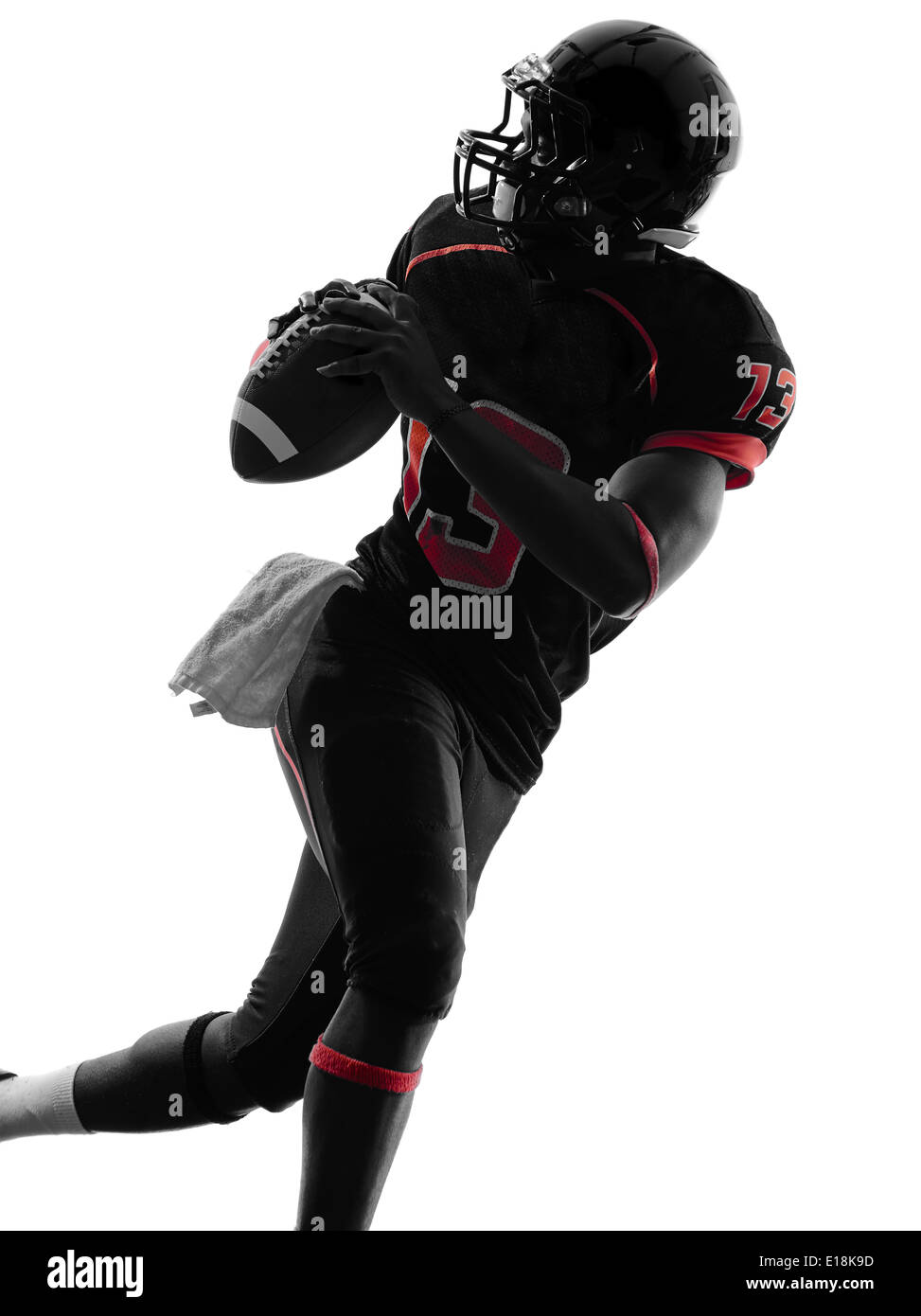 one american football player quarterback portrait in silhouette shadow on white background - Stock Image