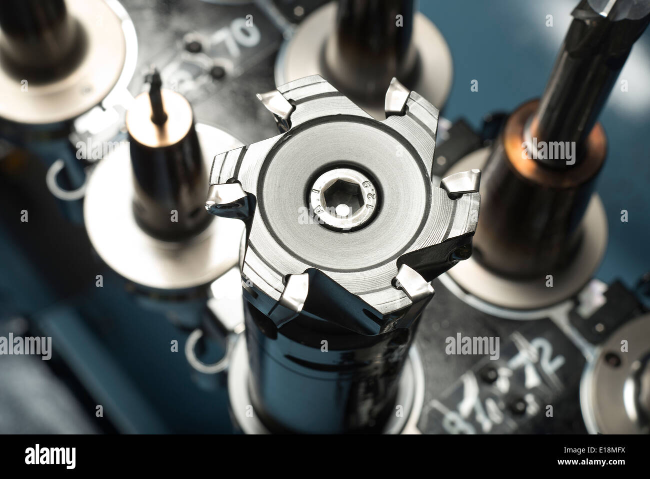 Drill bits for machining metal parts, in an engineering factory. - Stock Image
