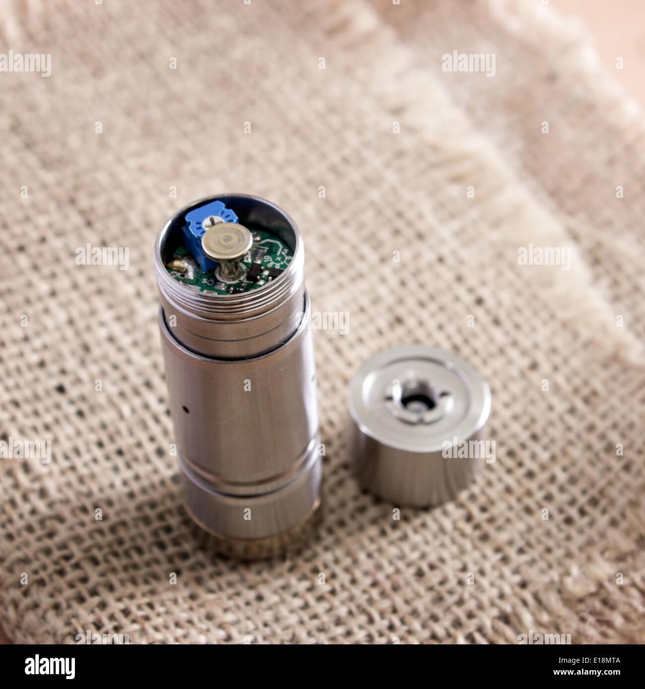 advanced vaping device, e-cigarette on table - Stock Image