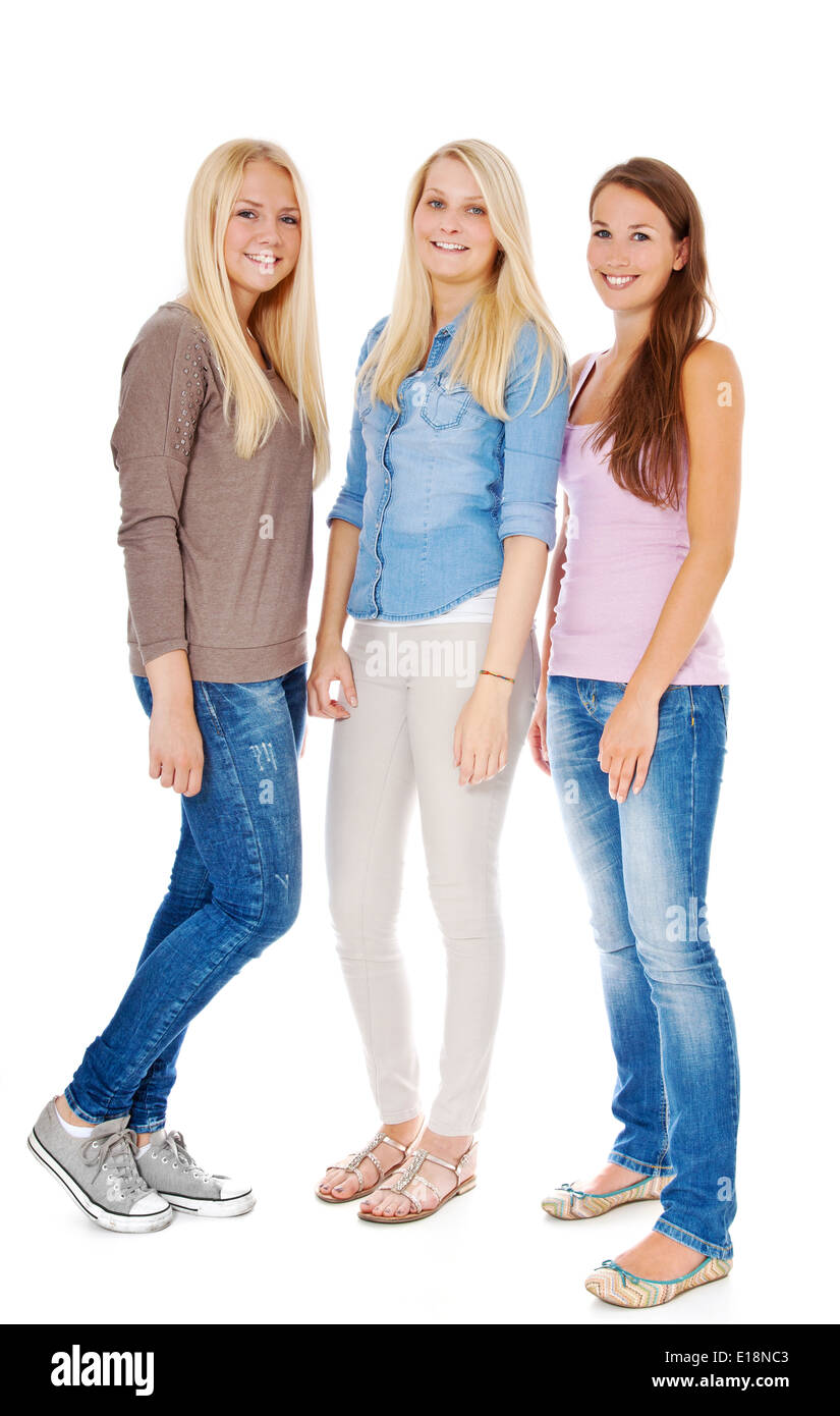 three attractive girls standing next to each other stock photo