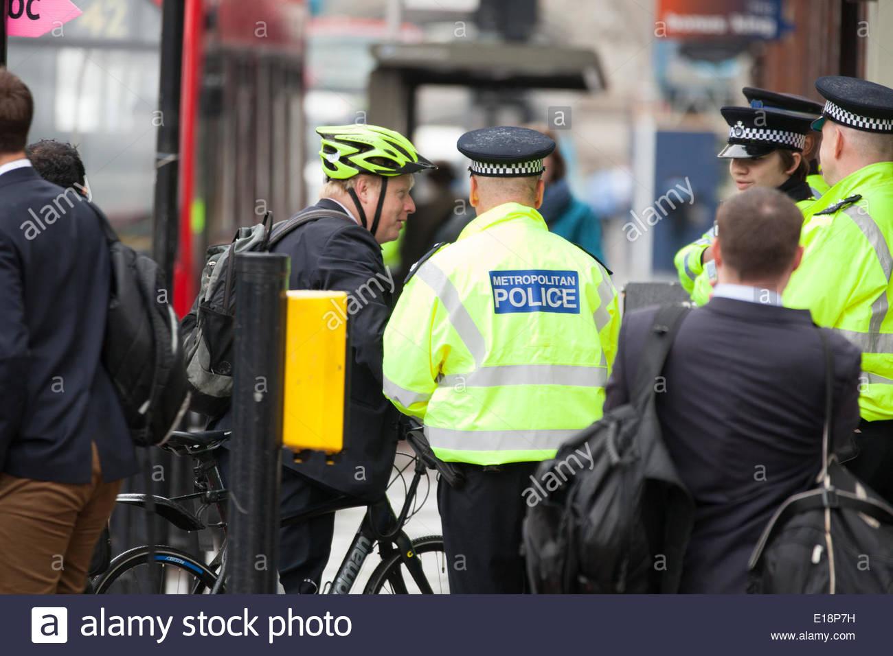 Tower Bridge Road, Bermondsey, London, UK 27th May 2014 Mayor of London Boris Johnson greeting and talking to the police Boris Johnson Road Saftey campaign by the Mayor of London 'Credit: Richard Soans/Alamy Live News' - Stock Image